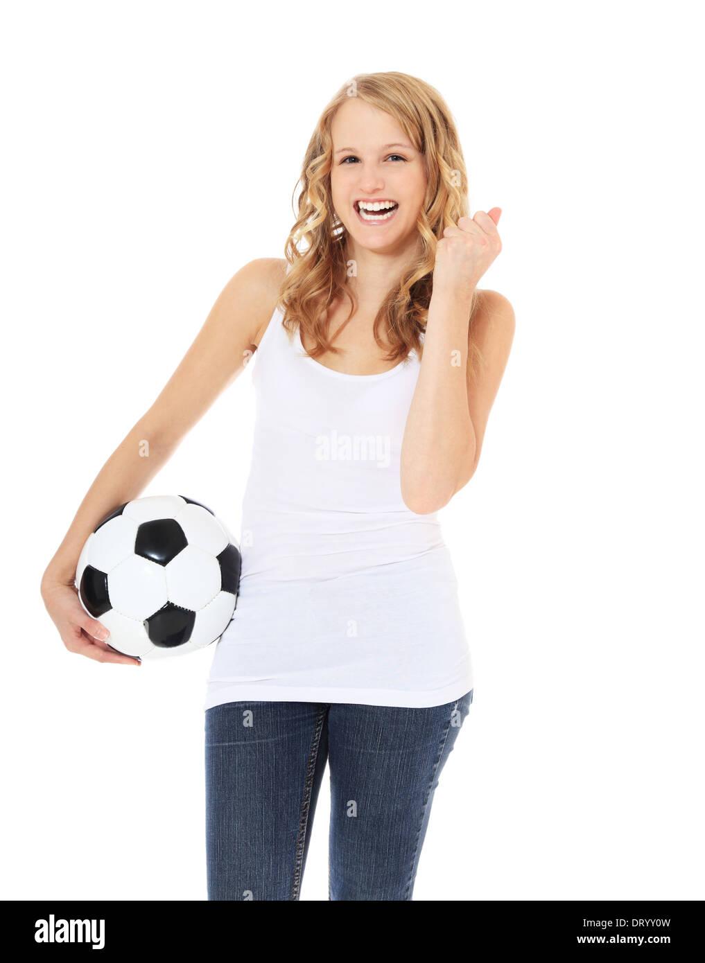 02dae47a64c76 Atractiva Chica sujetando una pelota de fútbol. Todo sobre fondo blanco.  Imagen De Stock