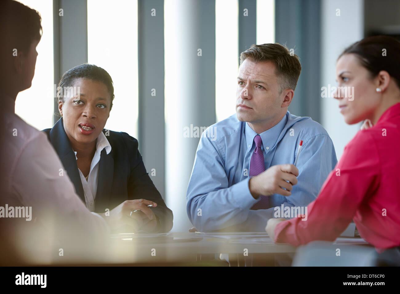 Los compañeros de negocio en reunión Imagen De Stock