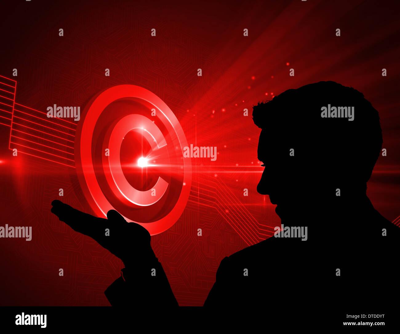 Imagen compuesta de color rojo brillante icono de copyright sobre fondo negro Foto de stock
