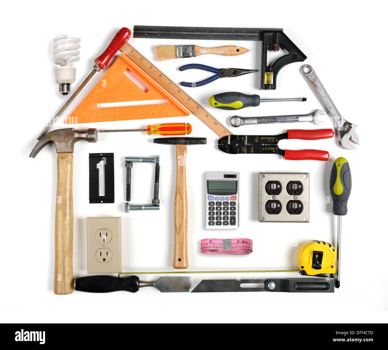 Herramientas formando una casa con eficiencia energética chimenea Imagen De Stock