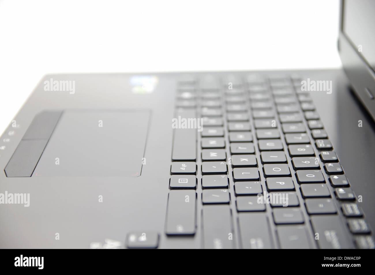 Teclado de portátil negro y la superficie del touchpad Imagen De Stock