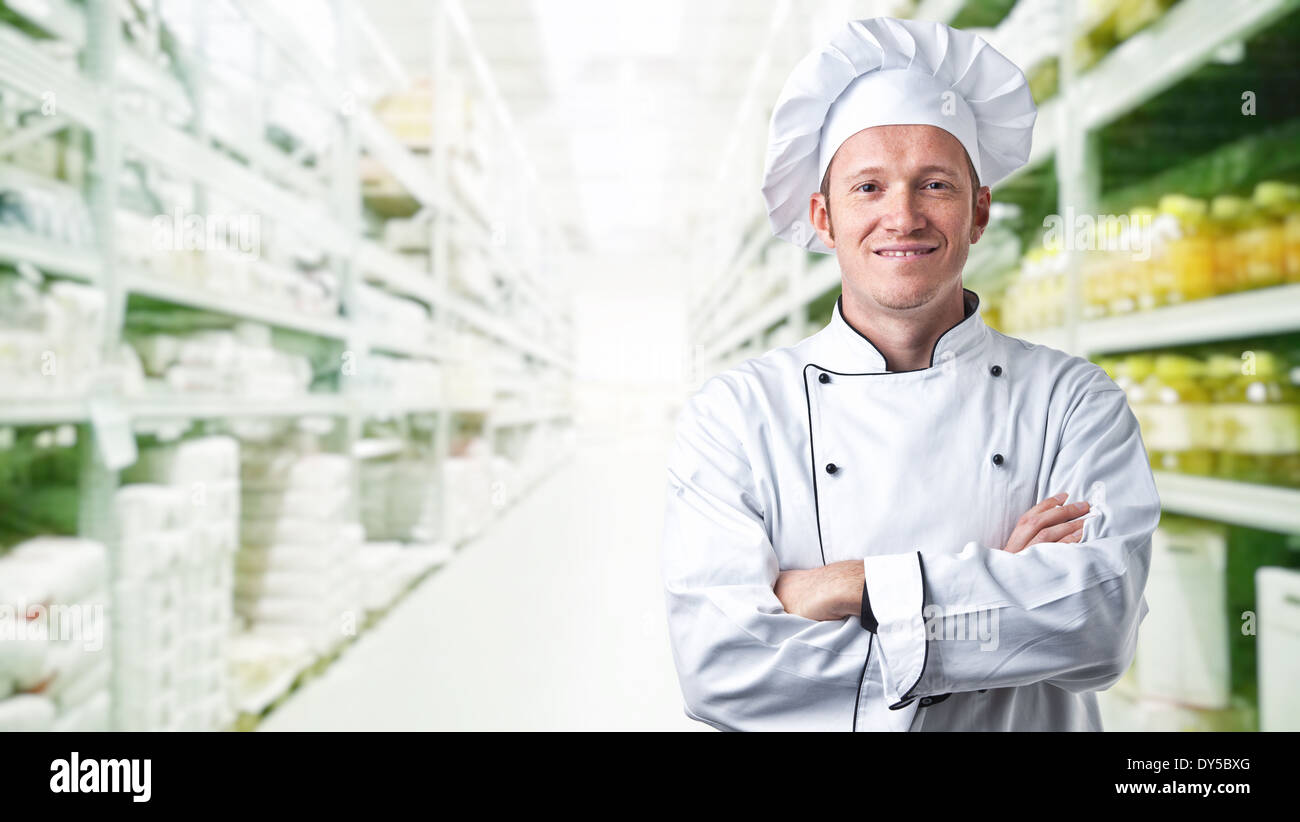 Retrato de chef y fondo de almacén Foto de stock