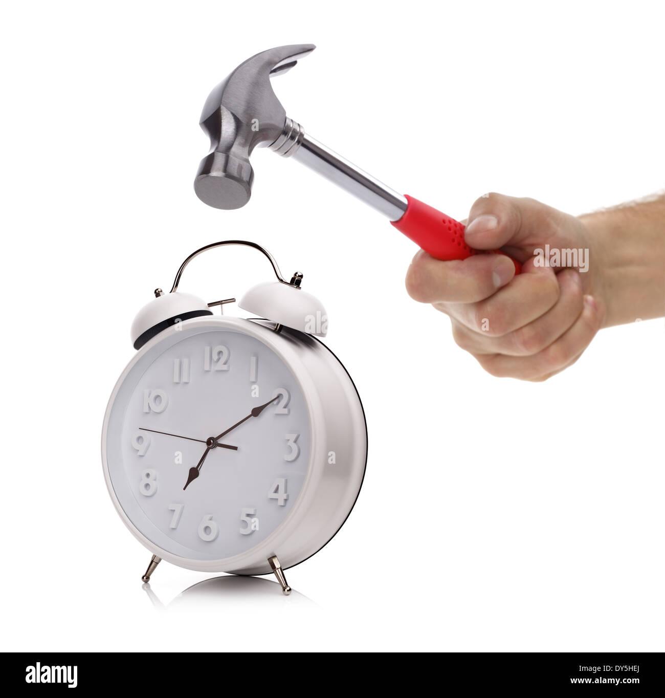 Reloj con alarma y martillo Imagen De Stock
