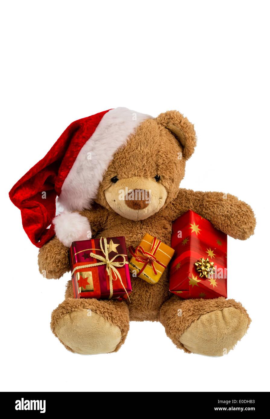 Un oso de peluche con regalos en Navidad. Cuando Santa Claus se viste de fiesta., Ein Teddybaer mit Geschenken zu Weihnachten. Weihnach als Foto de stock