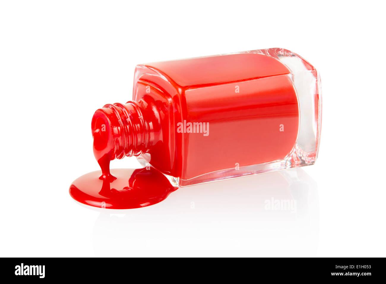 Esmalte de uñas de color rojo derramado Imagen De Stock