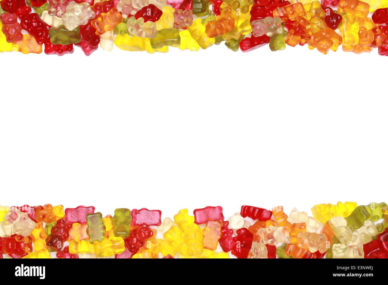 Colección de coloridos deliciosos ositos formando un bastidor. Foto de stock