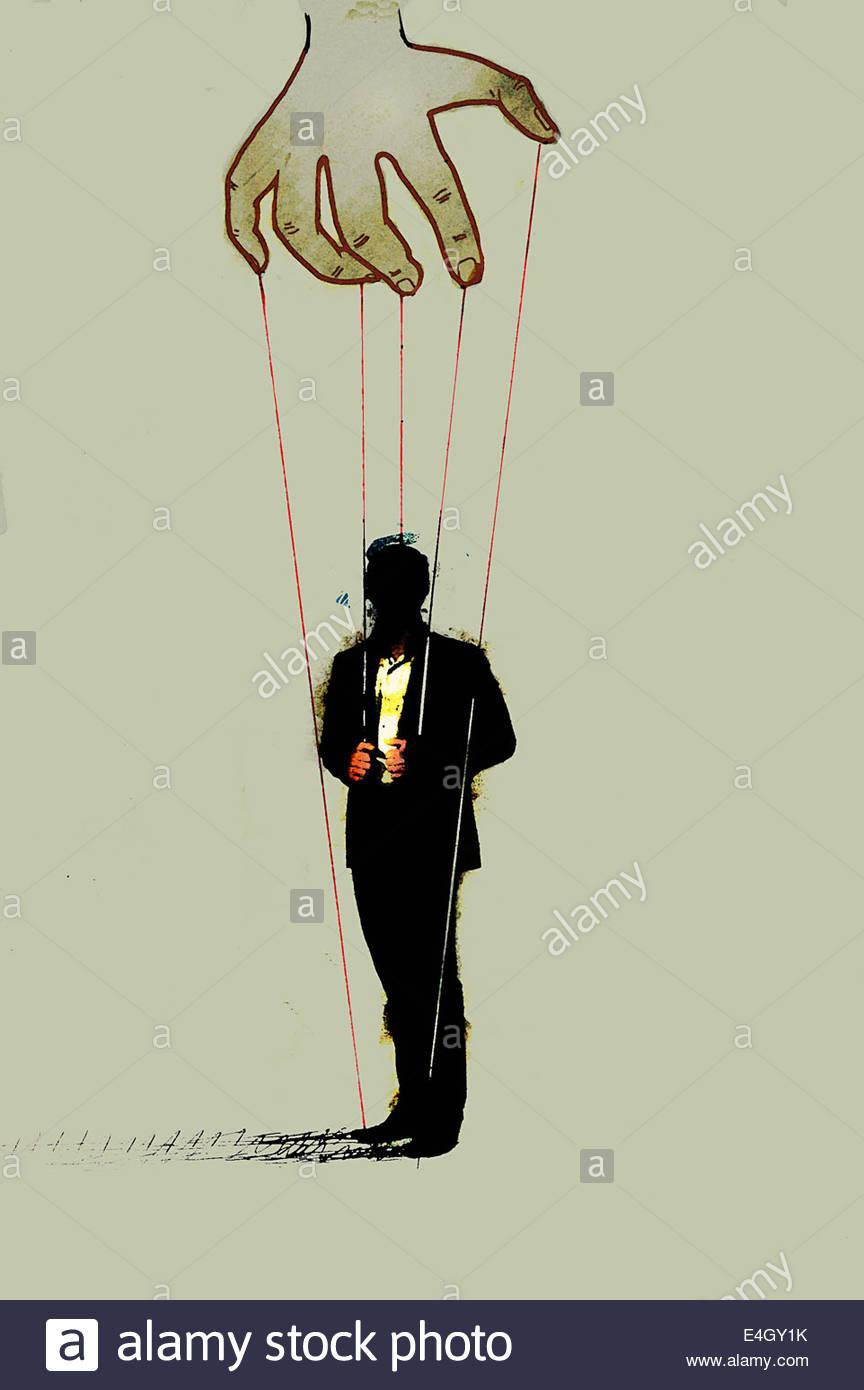 El empresario que controla el lado de marionetas Imagen De Stock