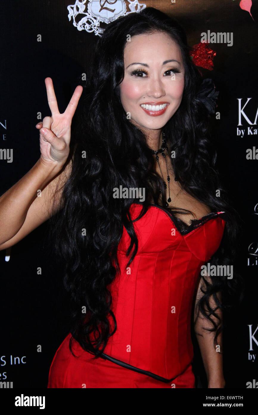 La sociedad del Unici Rosso evento patrocinado por Viva Glam Magazine celebró en Casa Unici - Llegadas Con: Imagen De Stock