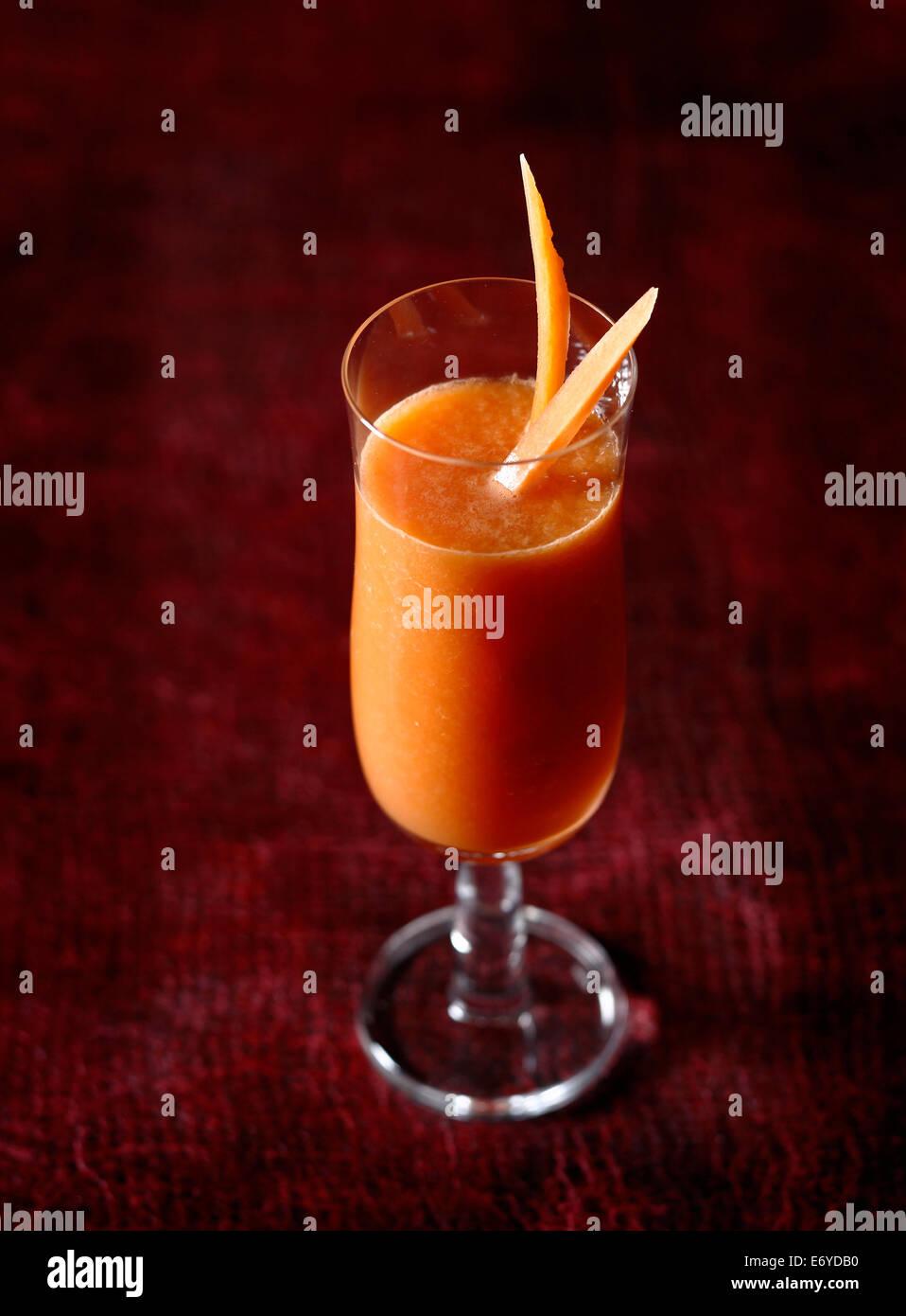 Zanahoria, melón y el zumo de limón Imagen De Stock