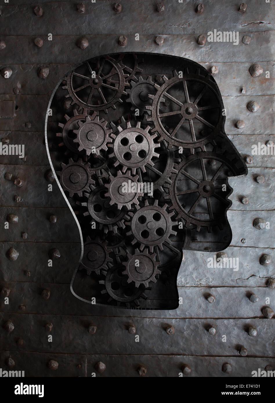 Concepto de cerebro: engranajes metálicos y dientes en cabeza humana Imagen De Stock