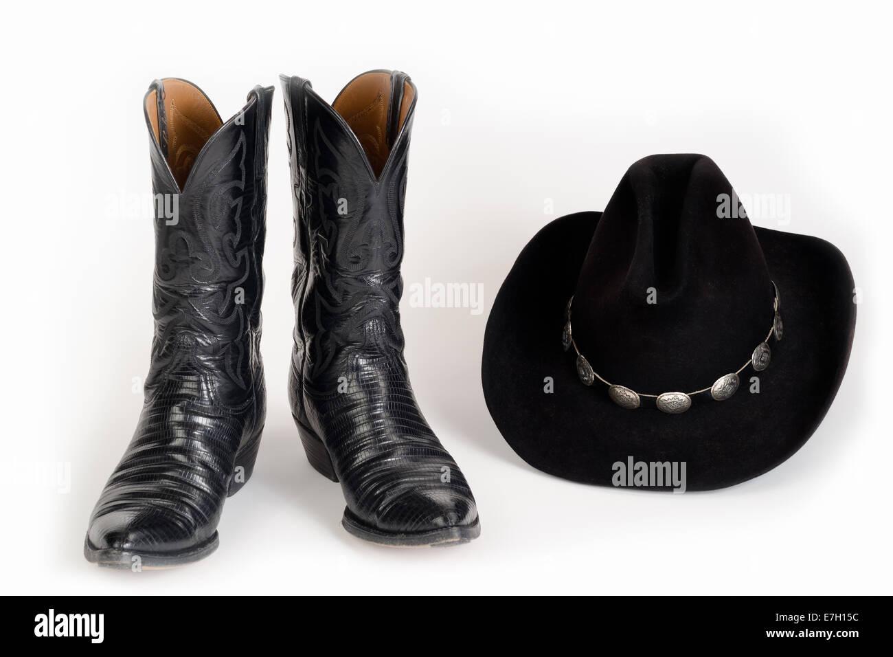 Botas de vaquero y un sombrero negro con hatband concho Foto ... 28663787328