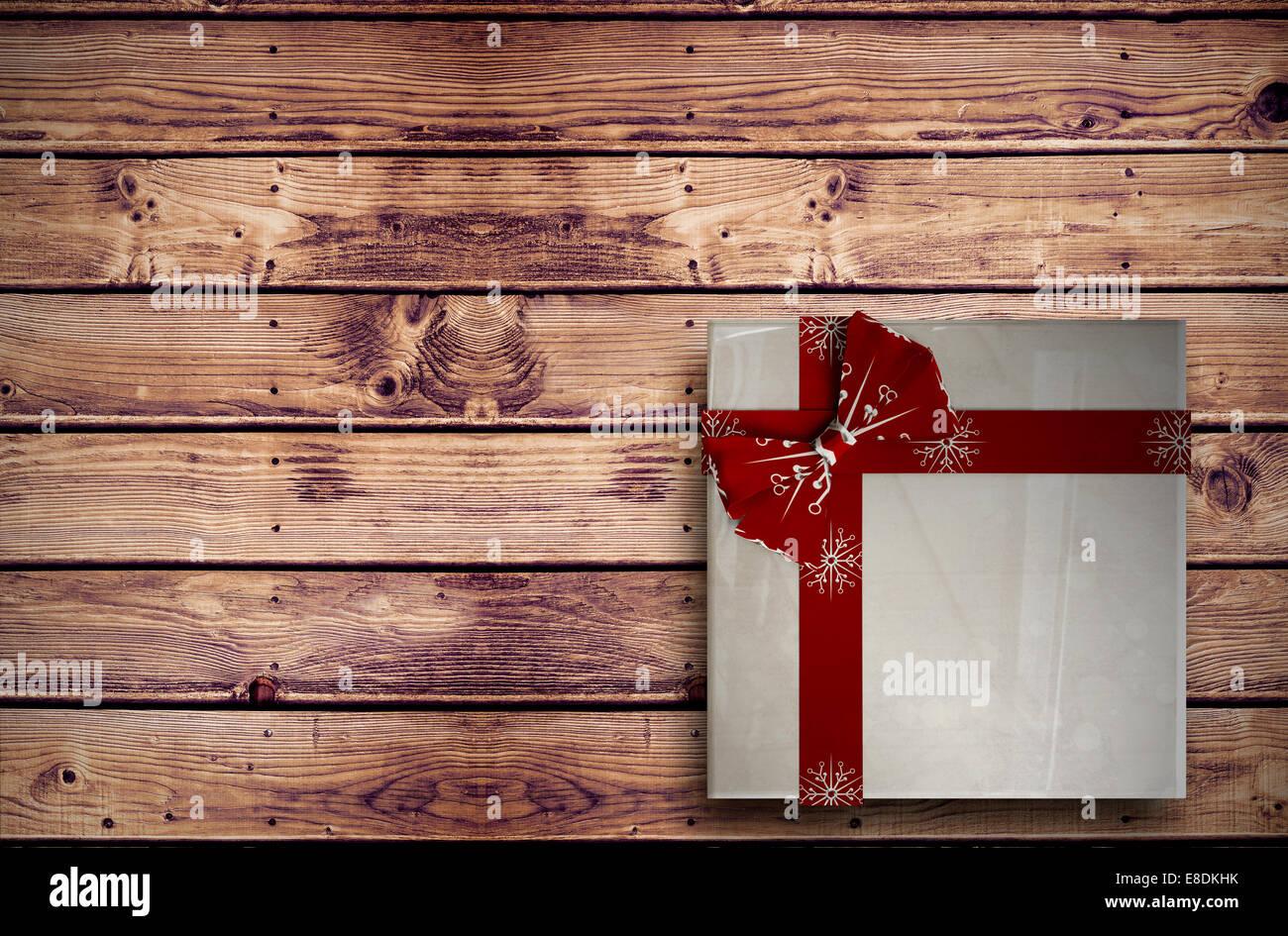 Imagen compuesta de regalo de navidad con arco Imagen De Stock