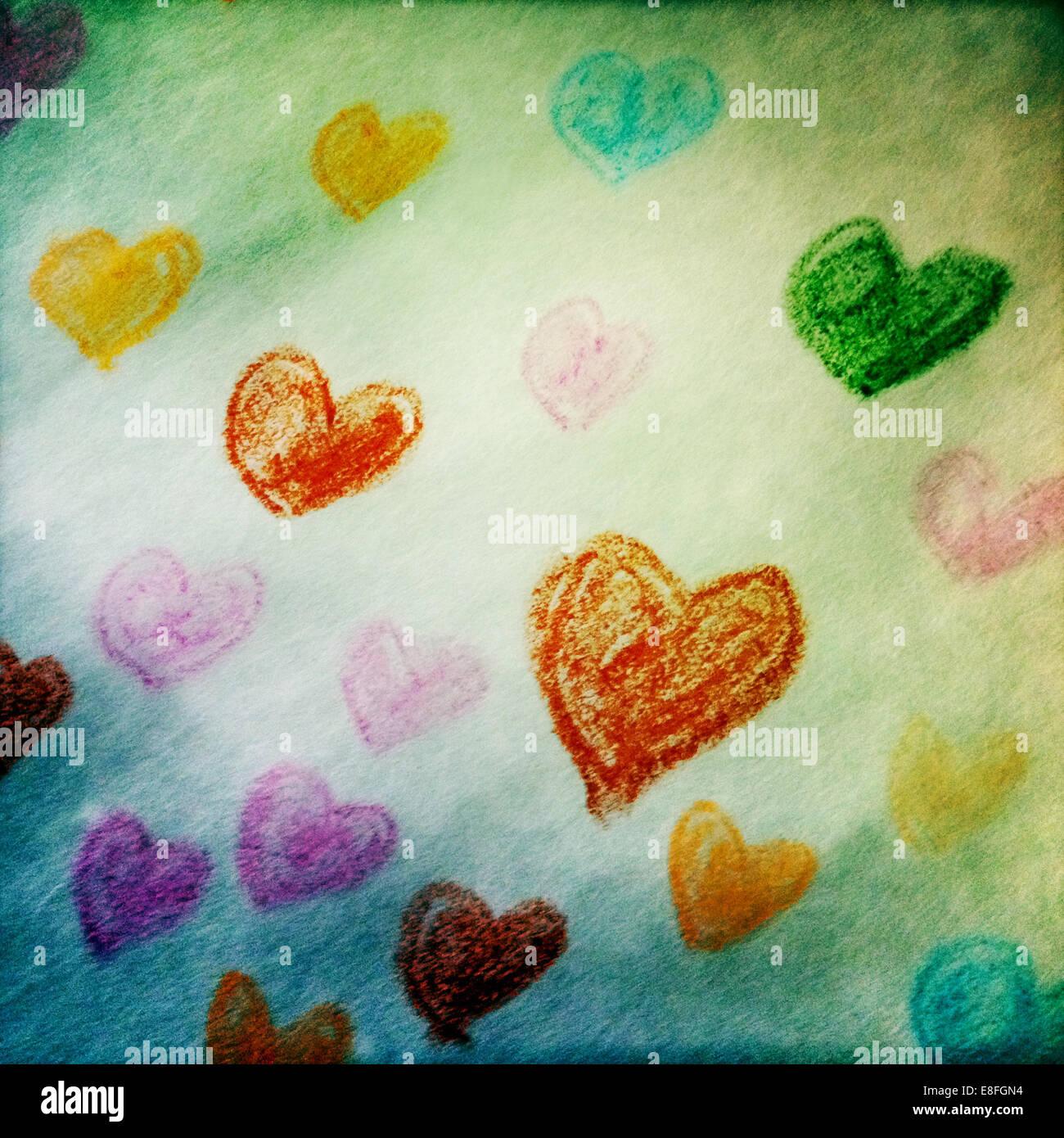 Multi-Colored corazones dibujados en un papel Imagen De Stock