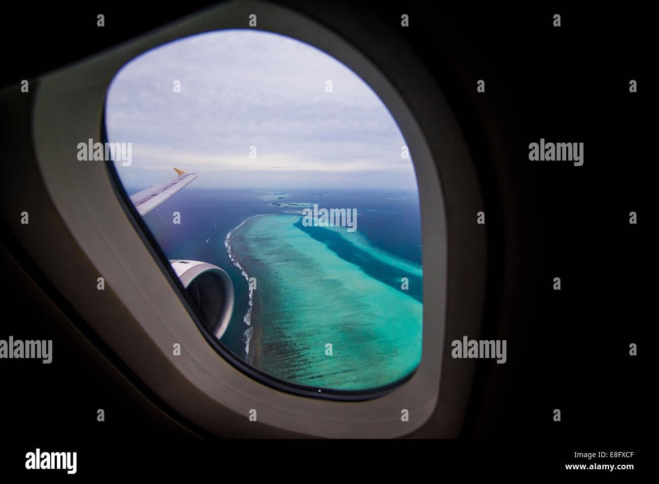 Maldivas, islas tropicales, visto desde la ventana de avión Imagen De Stock