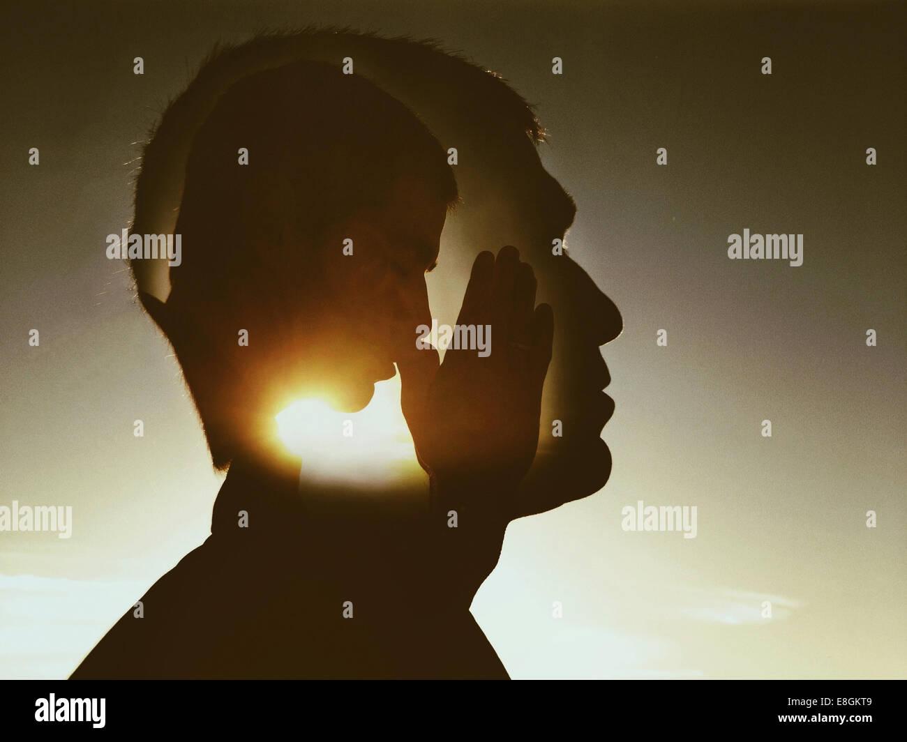 Compuesta digital del orante Imagen De Stock
