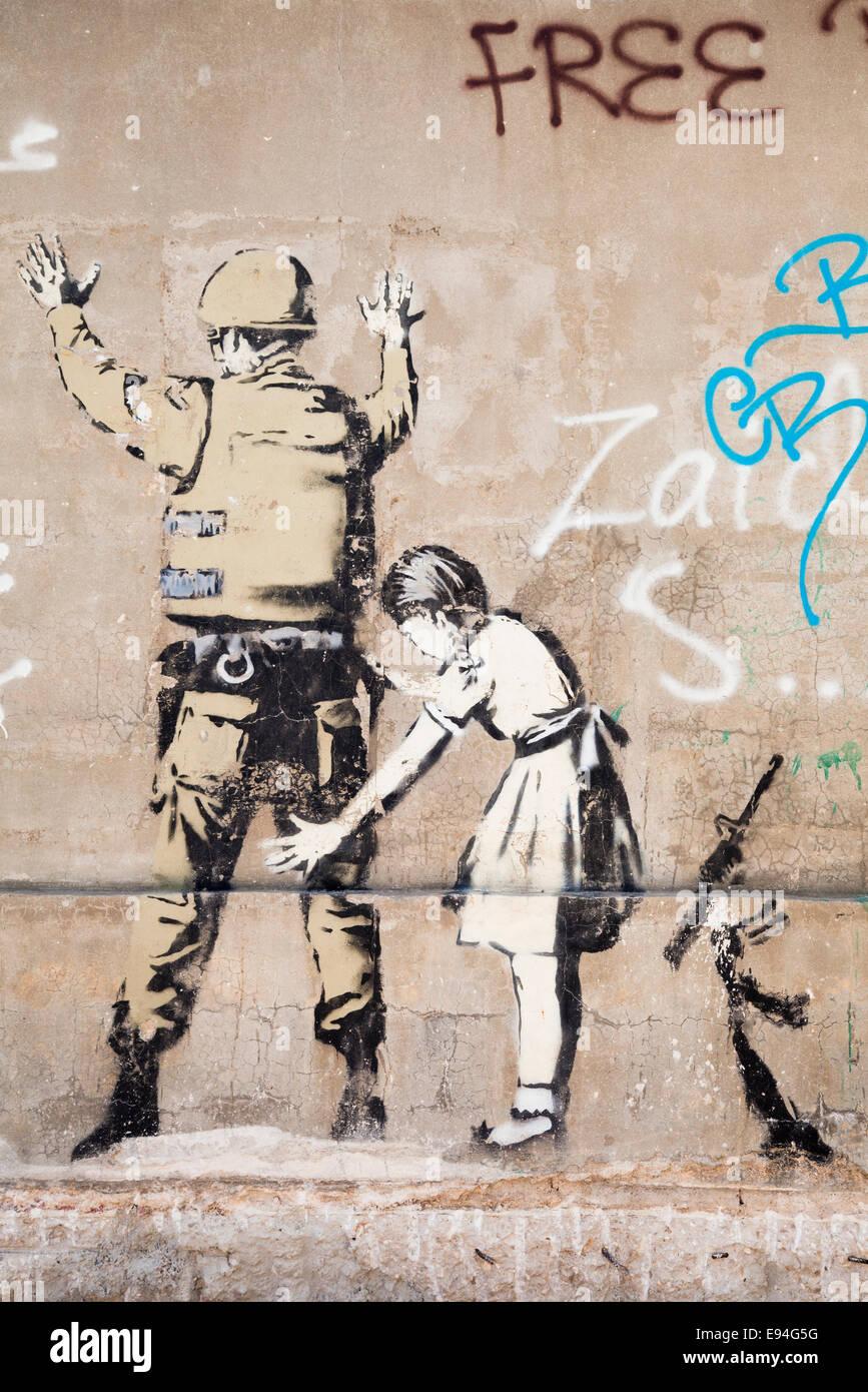 Banksy ilustración sobre el muro de seguridad israelí, Belén, Palestina Foto de stock