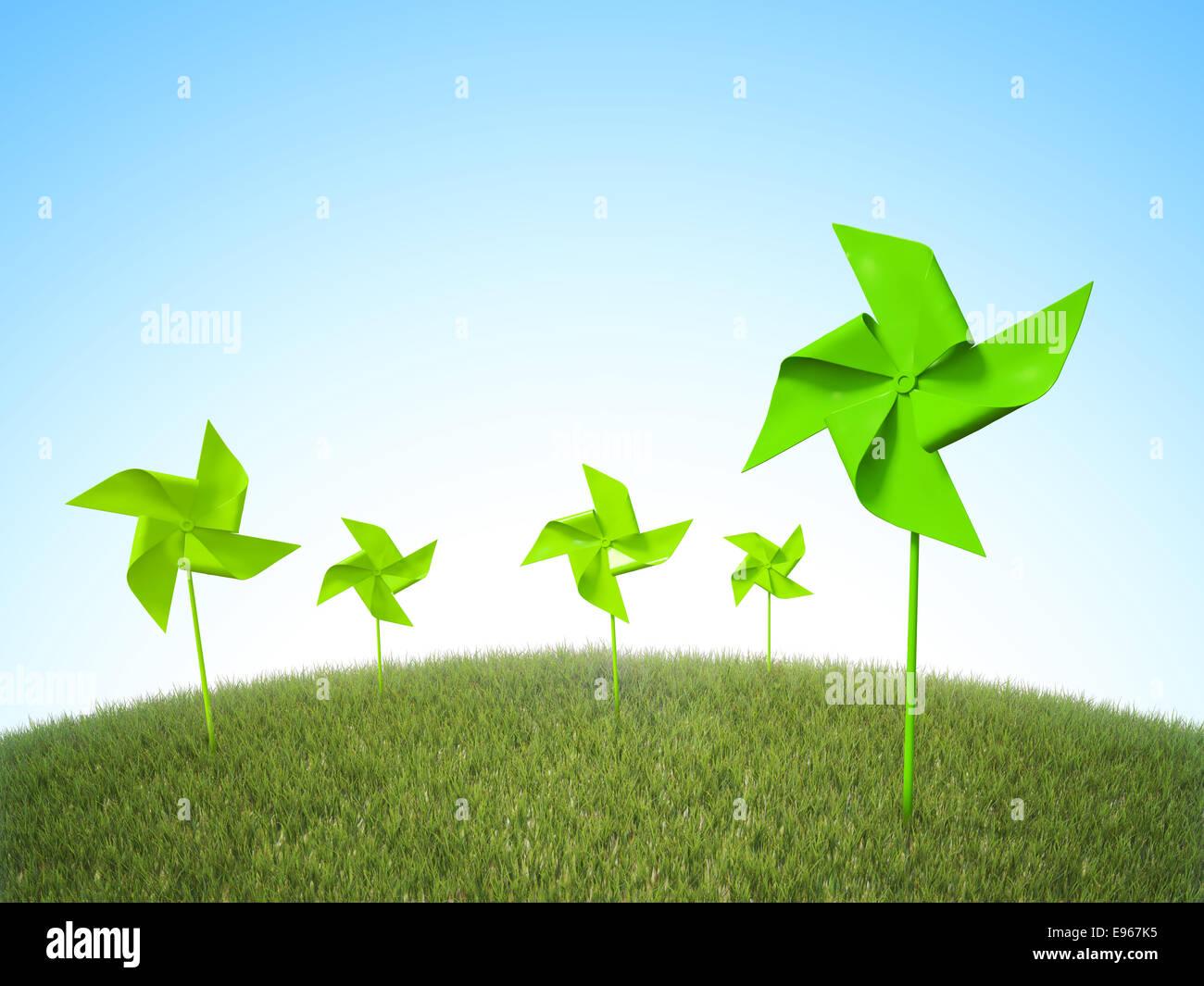 Rehiletes molinos de viento en un campo de hierba - Concepto de energía renovable Imagen De Stock