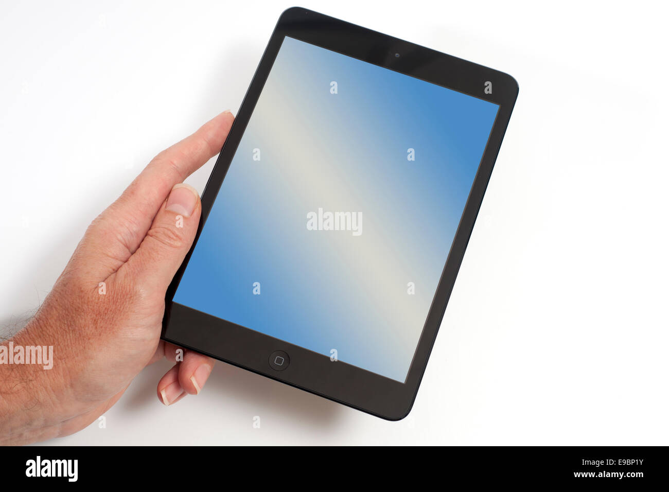 Ipad mini graduado con una pantalla en blanco. Imagen De Stock