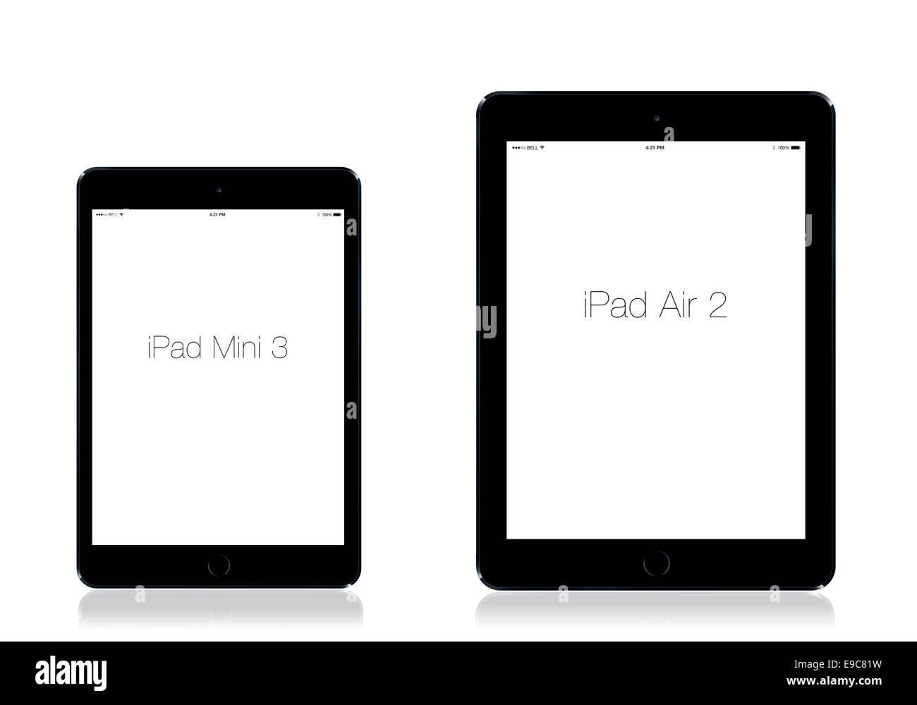 Tabletas iPad 3 y mini iPad 2 espacio de aire gris, fondo blanco, la reflexión. Imagen De Stock