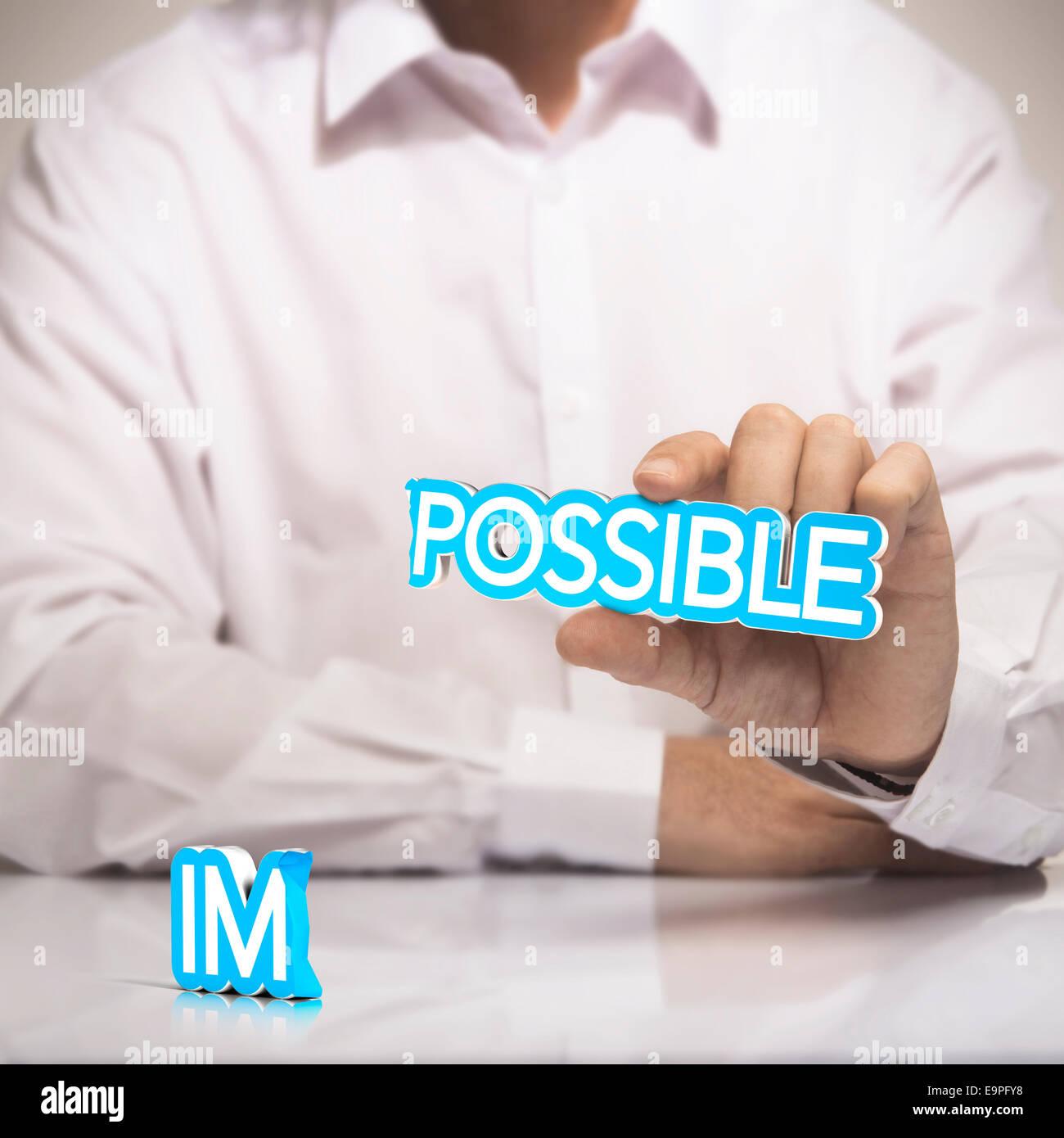 Posible versus imposible concepto de motivación. Un hombre sujetando la palabra posible en una mano con el Imagen De Stock
