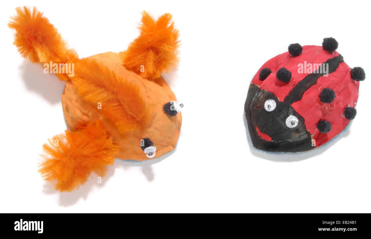 Fuzzy peces naranja y rojo y negro ladybug Imagen De Stock