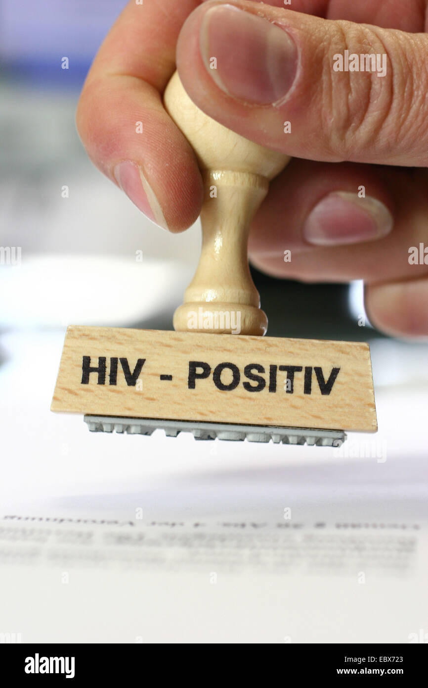 Mano con un sello de pacientes VIH-positivos, VIH positiv Imagen De Stock