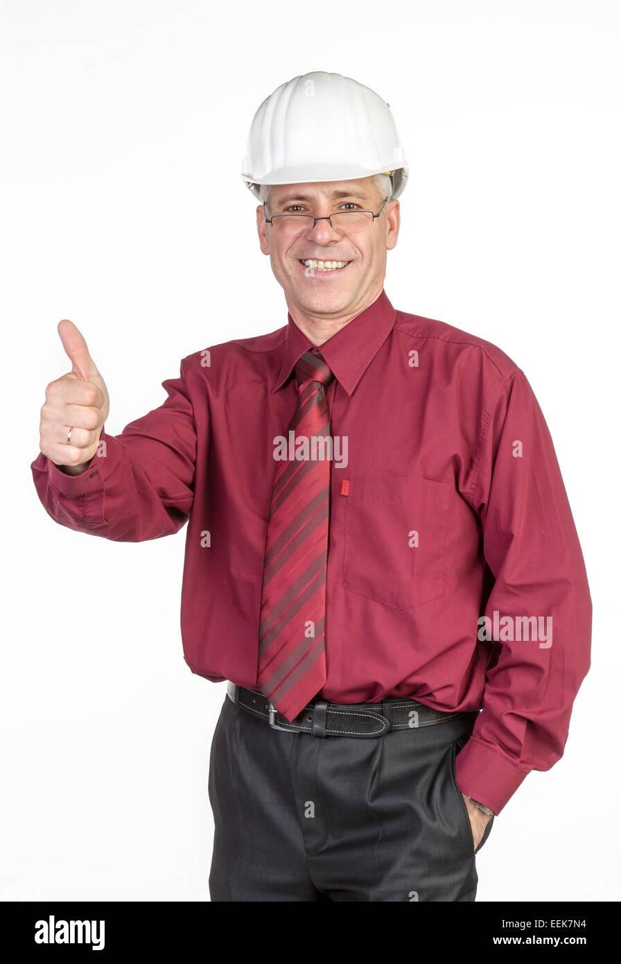 Architekt mit Helm hält Architekt Daumen hoch, con cascos de seguridad mantiene el pulgar Foto de stock