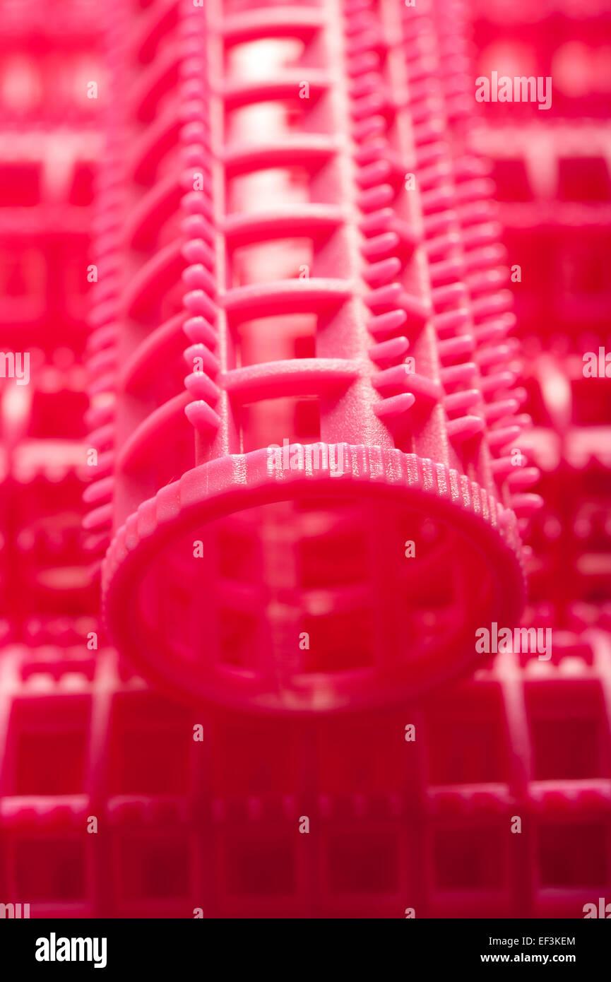 Resumen Antecedentes rosa de rizadores de pelo Imagen De Stock