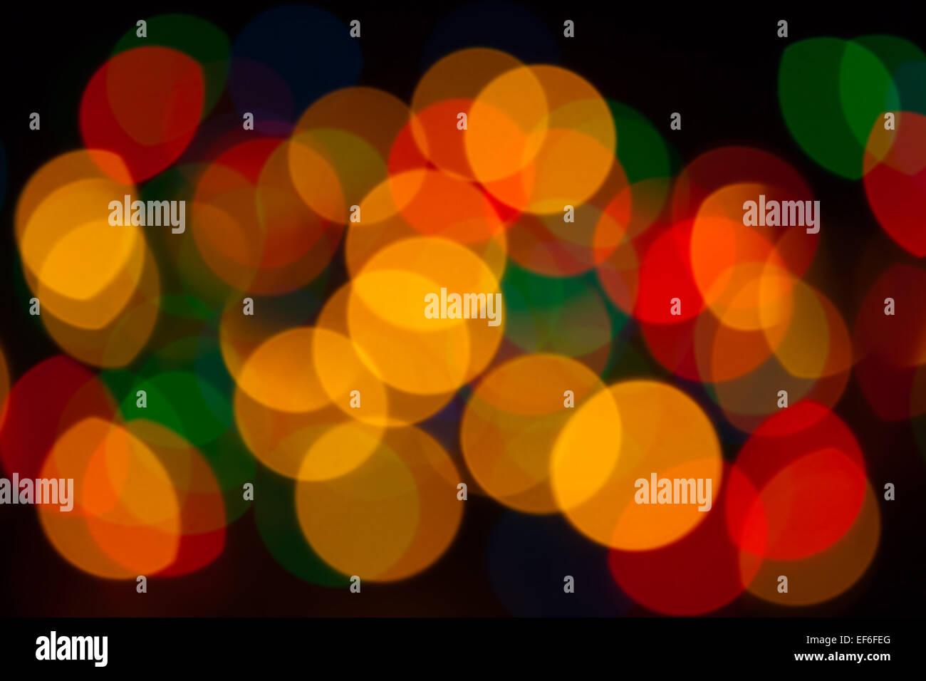 Resumen Antecedentes - desenfoque de objetos de colores luminosos sobre un fondo negro Imagen De Stock