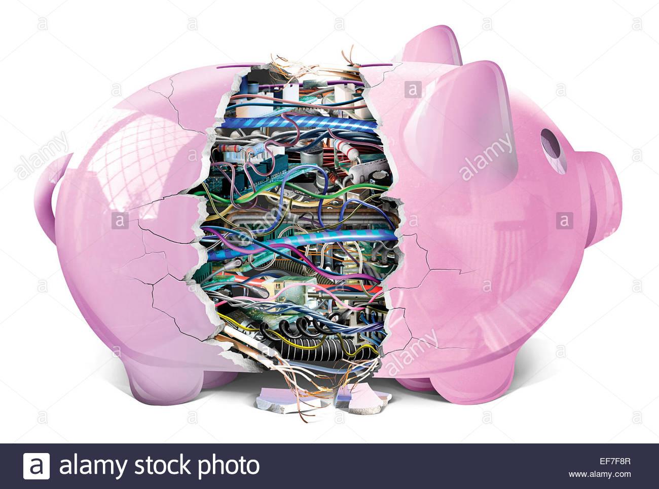 Hucha rota revelando electrónica complicada Imagen De Stock