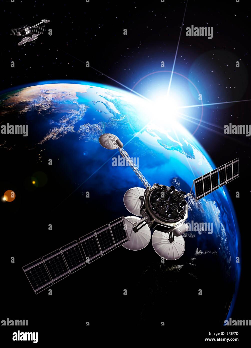 Los satélites de comunicaciones sobre la tierra iluminada por el sol naciente. Espacio concepto de telecomunicaciones Imagen De Stock