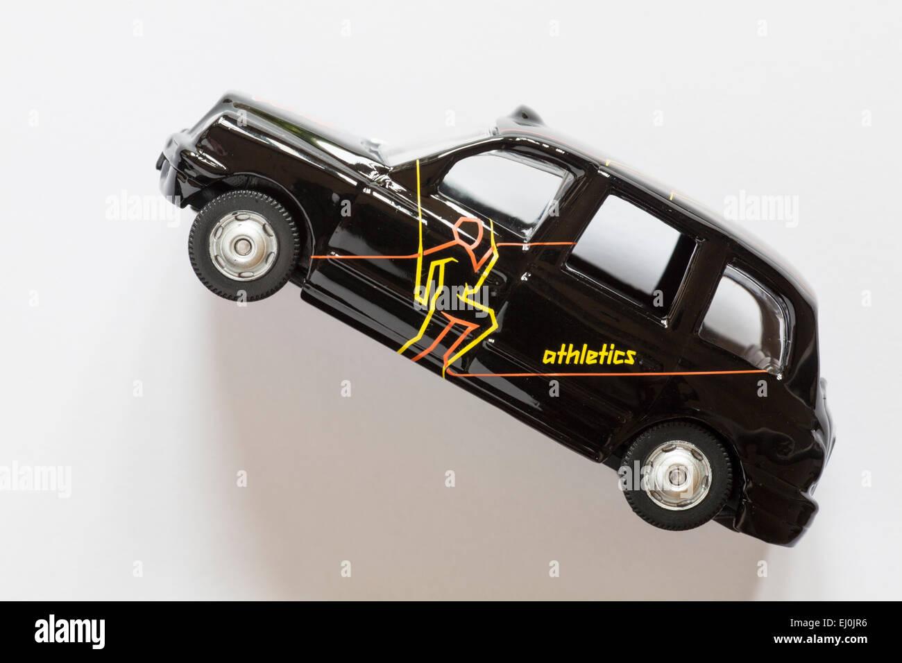 Destino de los taxis de Londres 2012 - juguete taxi negro de atletismo para los Juegos Olímpicos de Londres Imagen De Stock