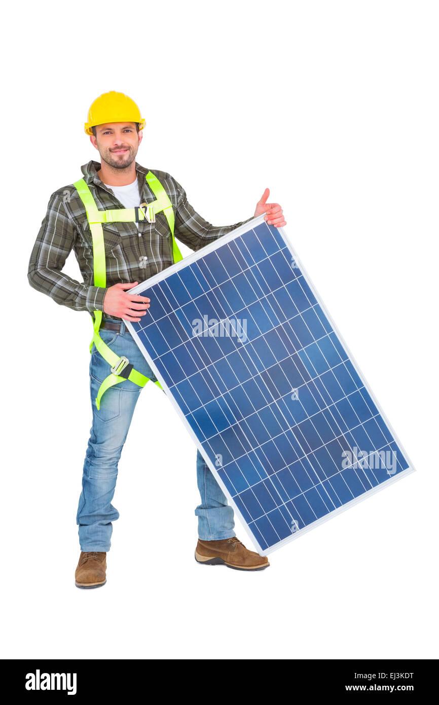 Sonriendo manitas con panel solar Imagen De Stock