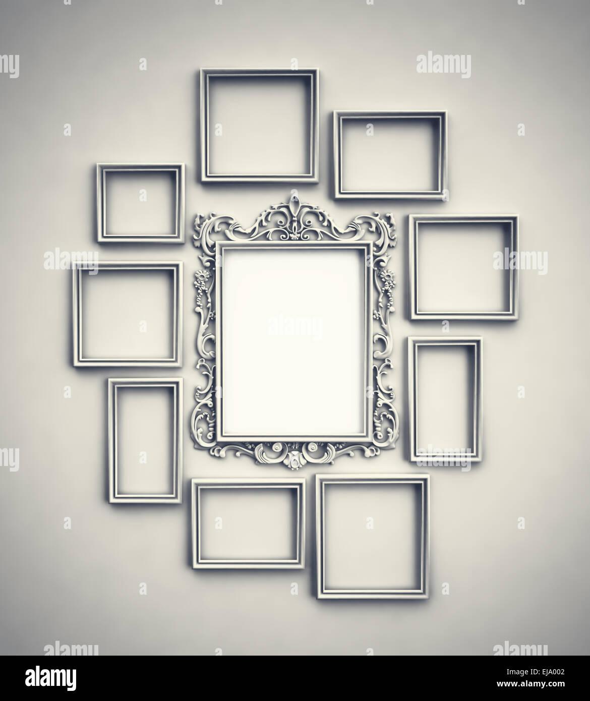 Pared simple con marcos ornamentados circundante en el centro del bastidor Imagen De Stock