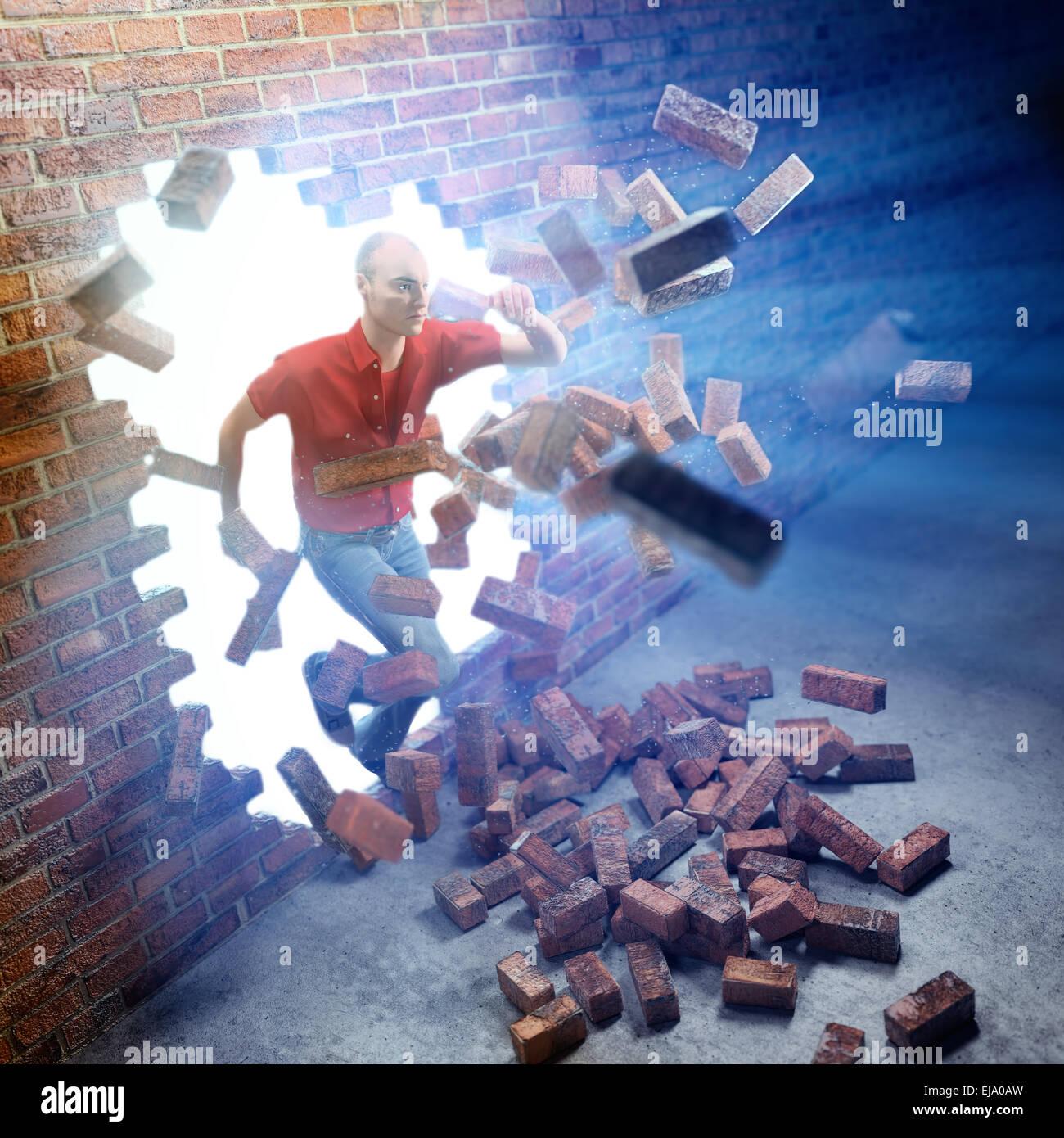 Joven corriendo a través de una pared de ladrillo Imagen De Stock