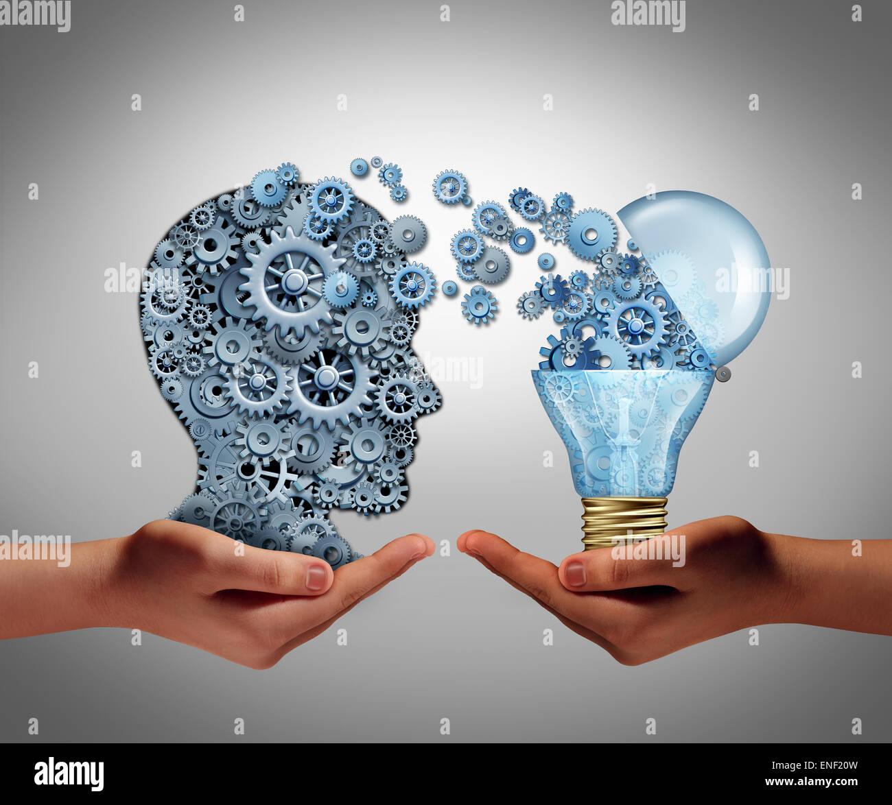 Concepto de creación de ideas y el logro de la aspiración símbolo de éxito como dos manos sosteniendo Imagen De Stock
