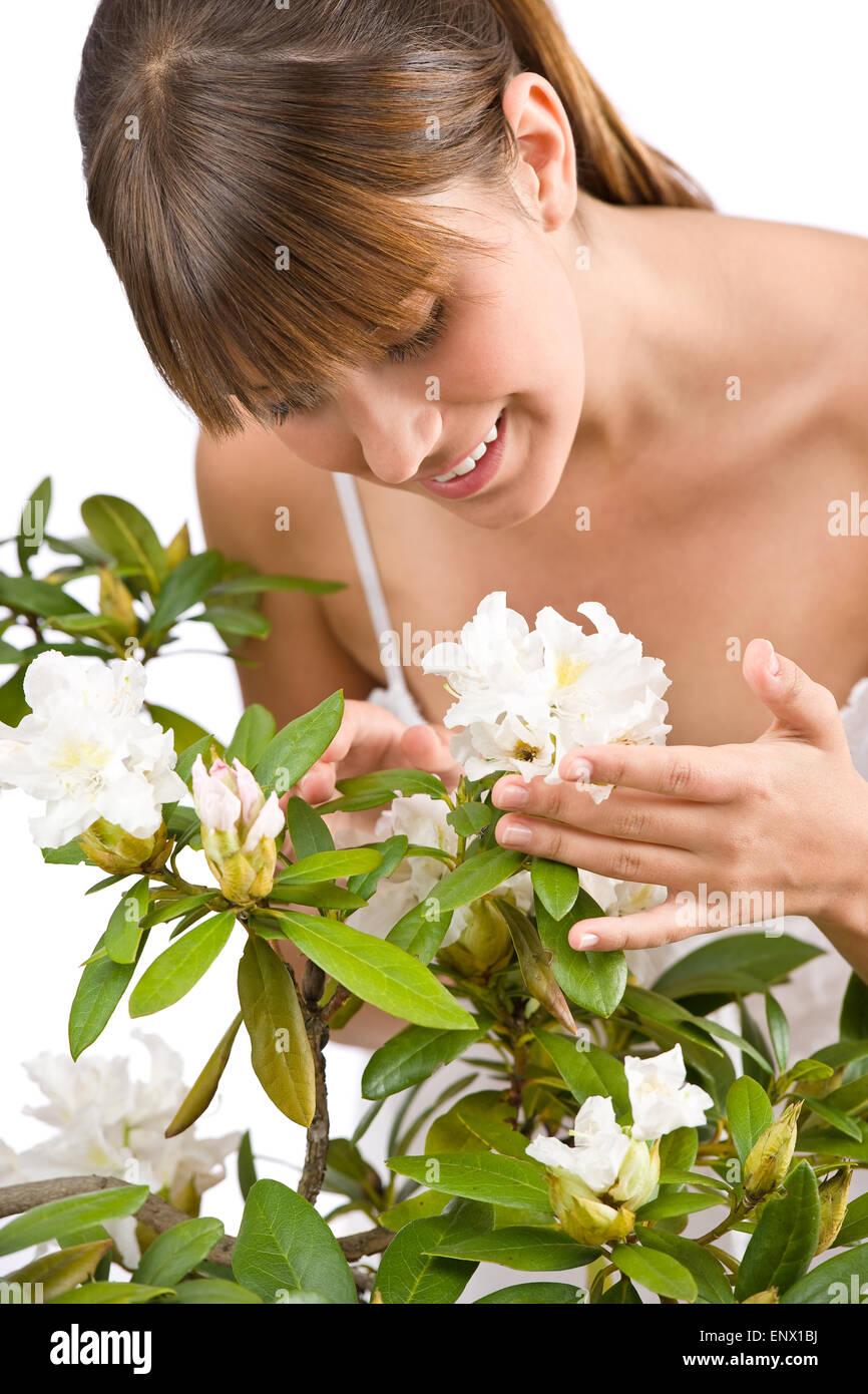 Jardinería - Retrato de mujer con Rhododendron Foto de stock