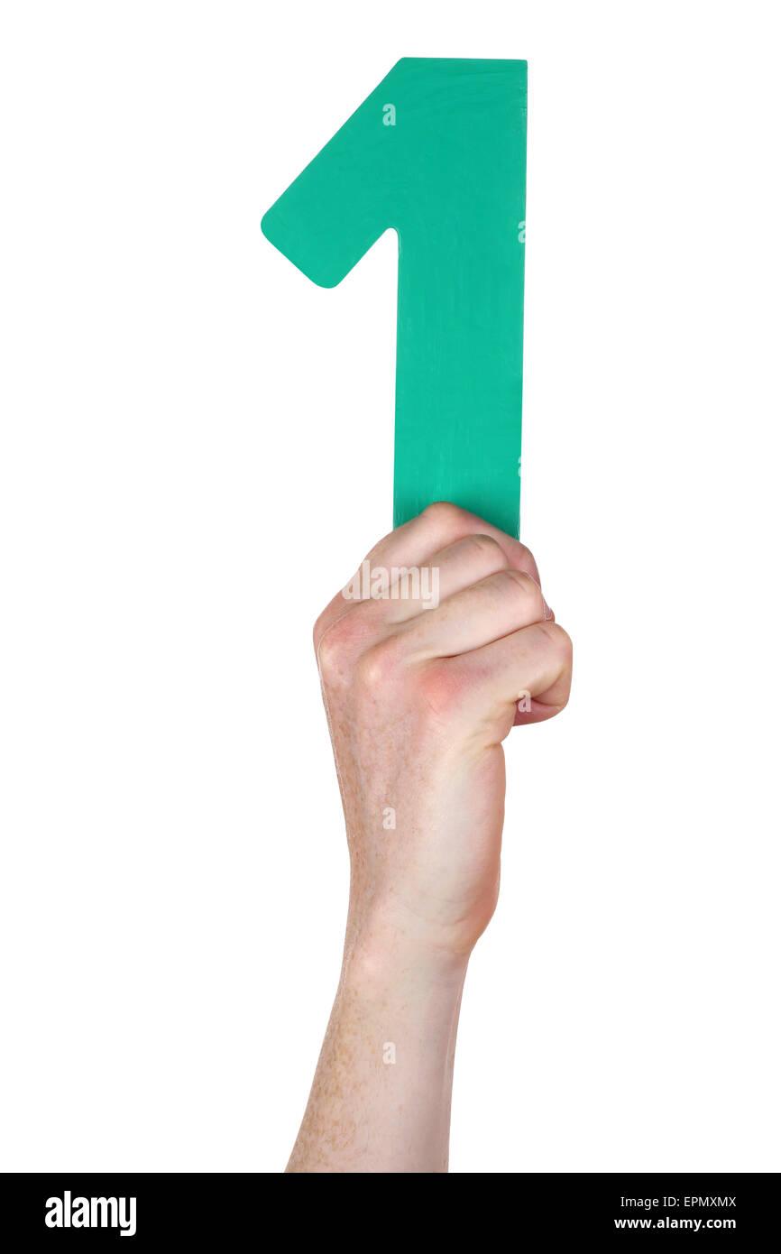 Mano sujetando el número 1 aislado en un fondo blanco. Foto de stock