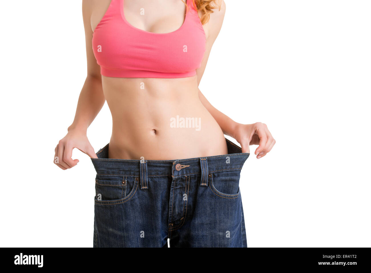 Mujer a ver los resultados de su dieta, aislado en blanco Imagen De Stock
