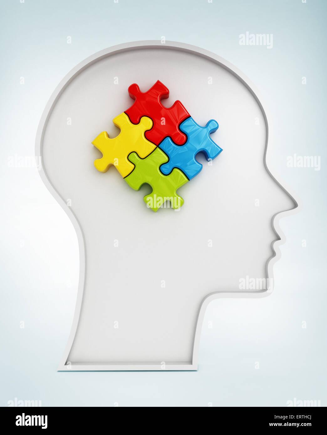 Las piezas de un rompecabezas de cuatro colores en forma de cabeza humana Imagen De Stock