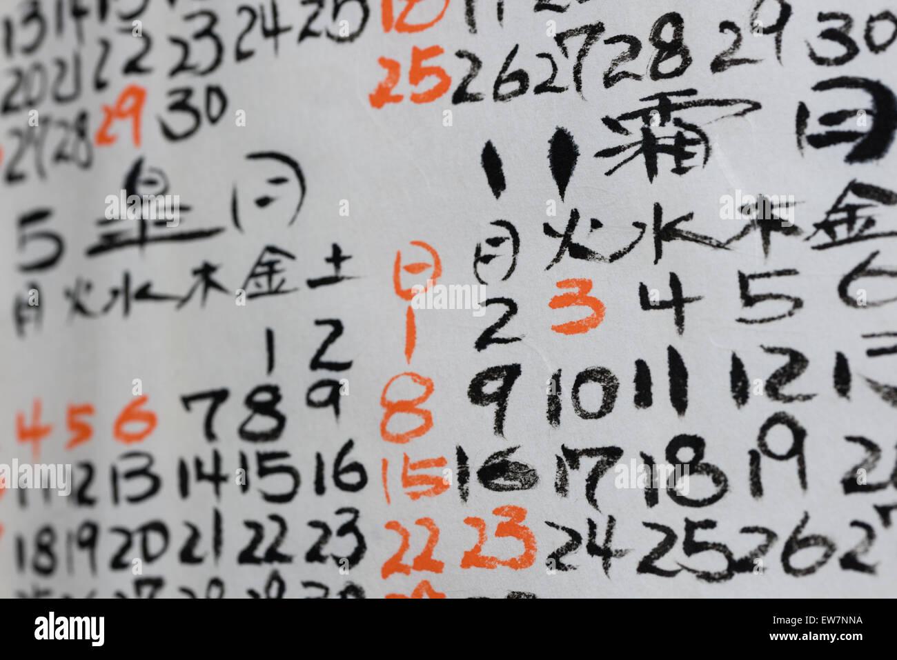 Calendario Japones.Algunos Numeros Escritos A Mano Y Los Kanji En Un Calendario Japones