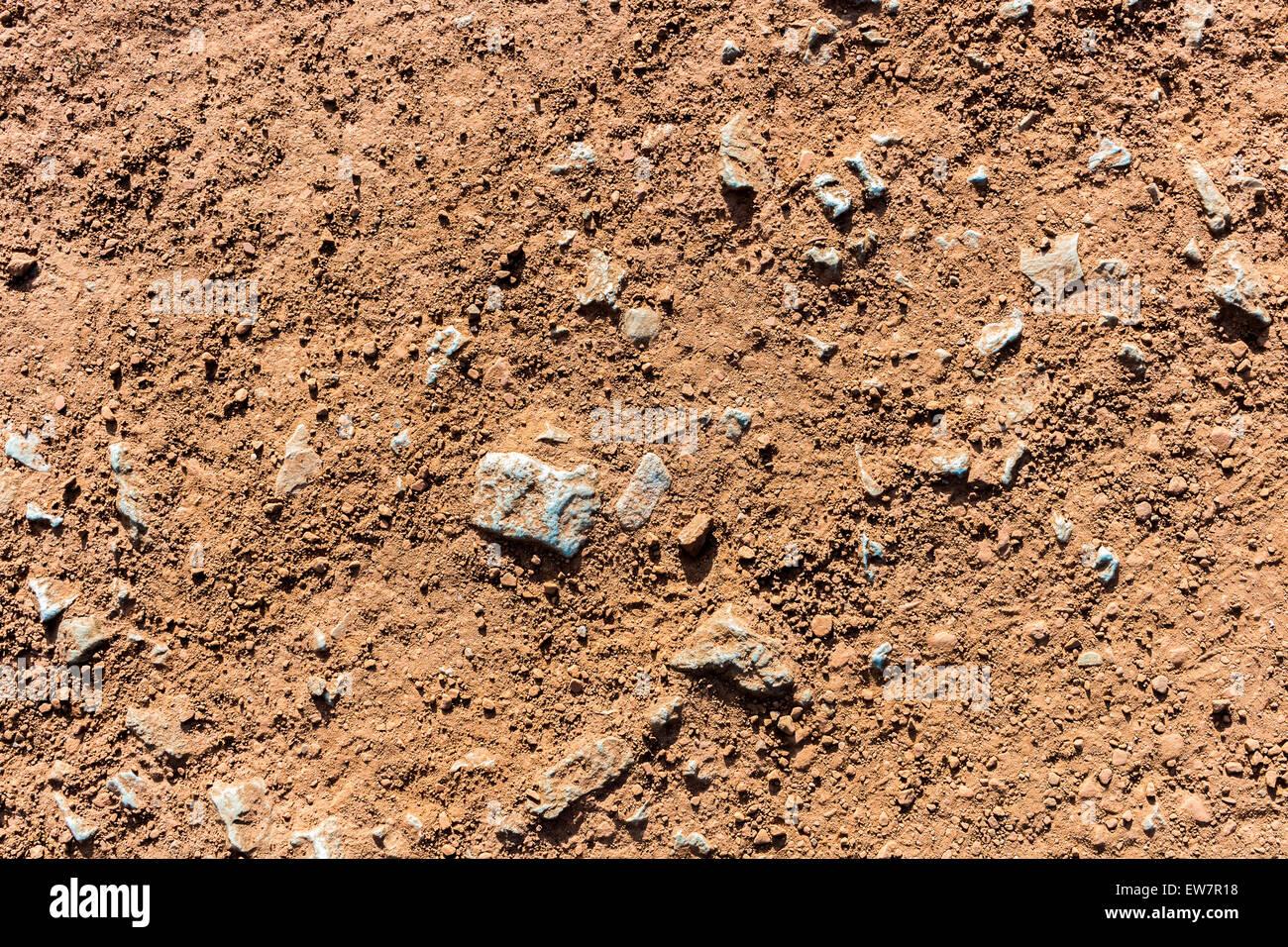 Las piedras rojas de la arena textura del fondo en los deportes campo corredores vía Imagen De Stock