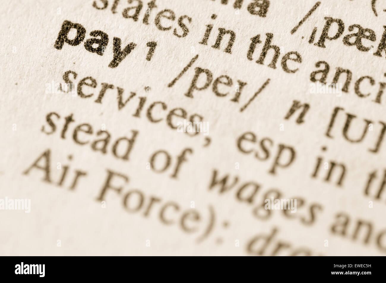 Definición de la palabra pagar en el diccionario. Foto de stock