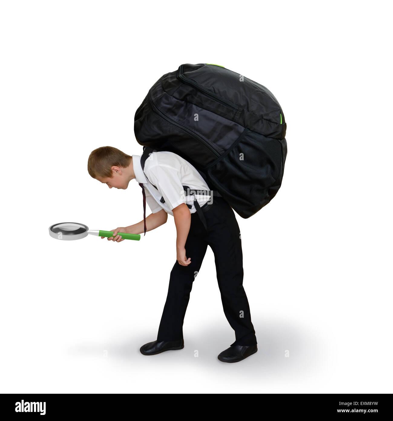 El colegial lleva una mochila y lupa Foto de stock