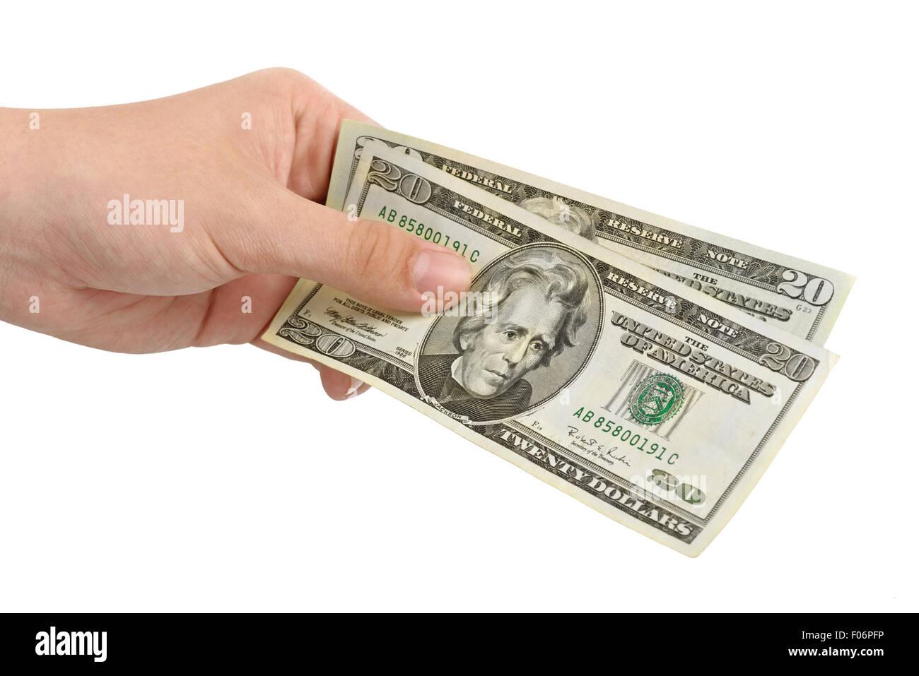 Mano con dinero dólares aislado sobre fondo blanco. Imagen De Stock