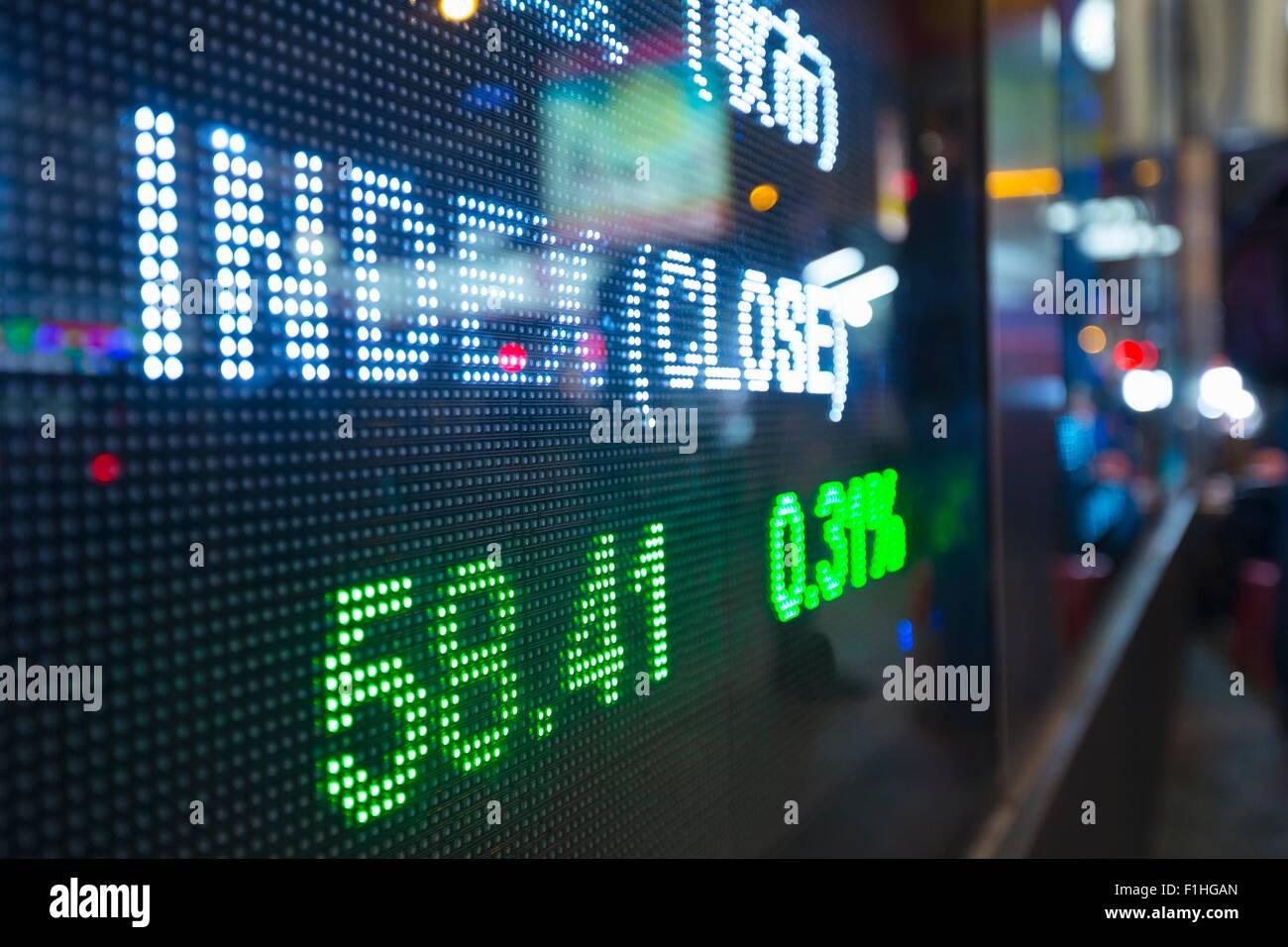 Pantalla digital para los cambios en el mercado bursátil, Hong Kong, China Imagen De Stock