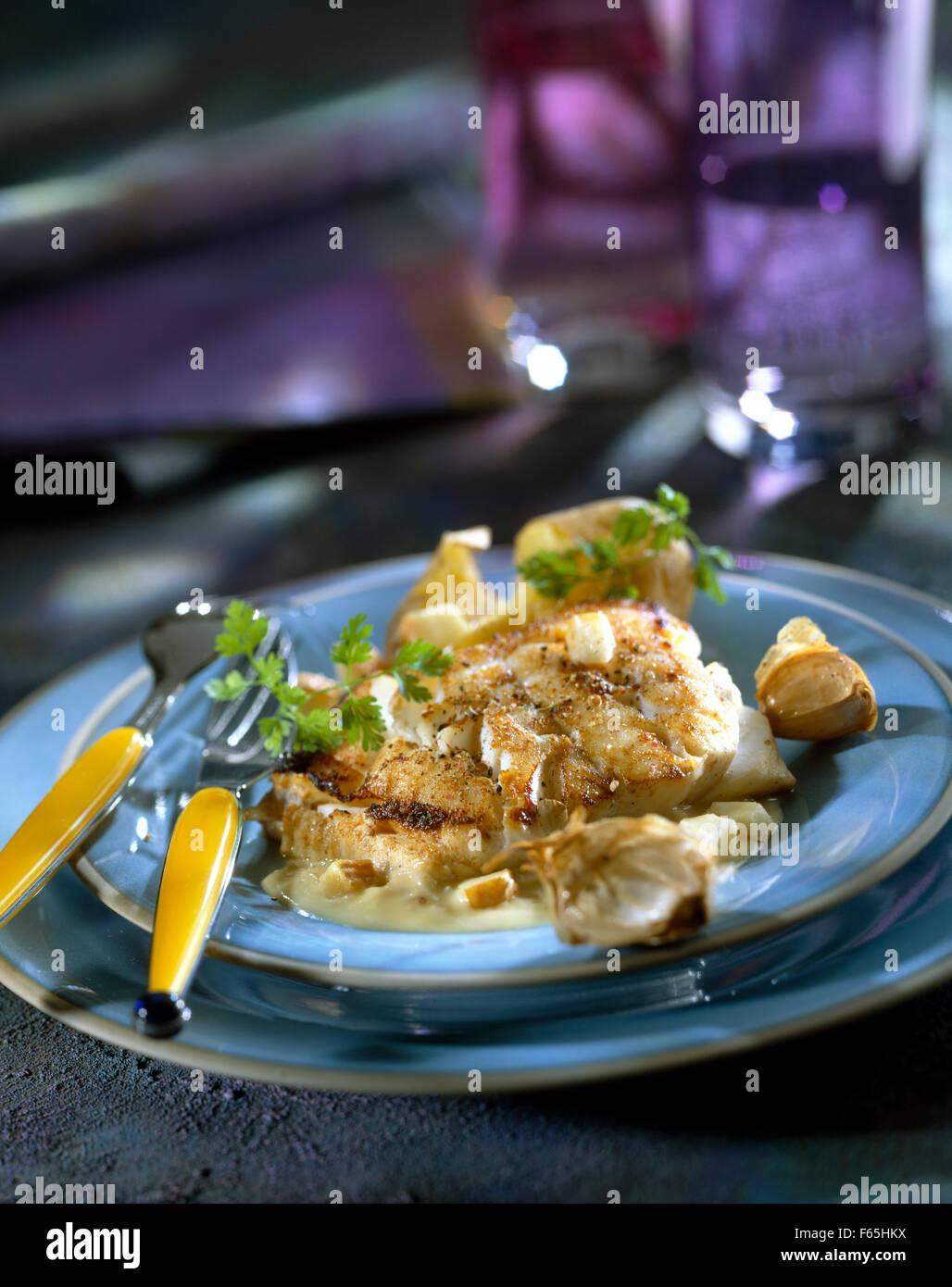 Bacalao con sal y cerveza blanca Maroilles Foto de stock
