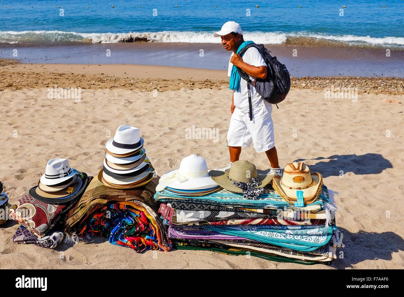 Hombre Vendiendo Sombreros Tapetes Alfombras Y Prendas De