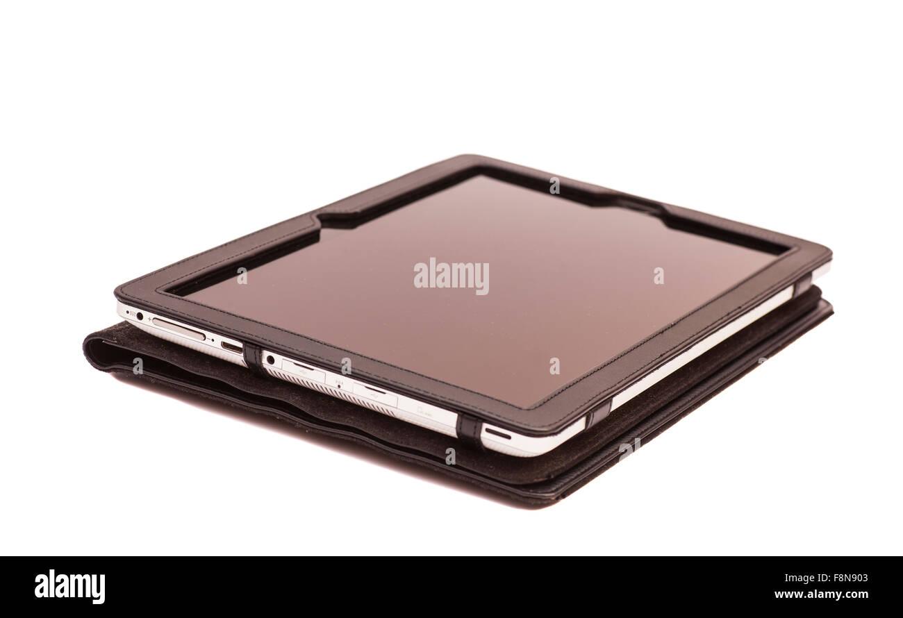 Tablet PC en la cubierta aislado en blanco Imagen De Stock