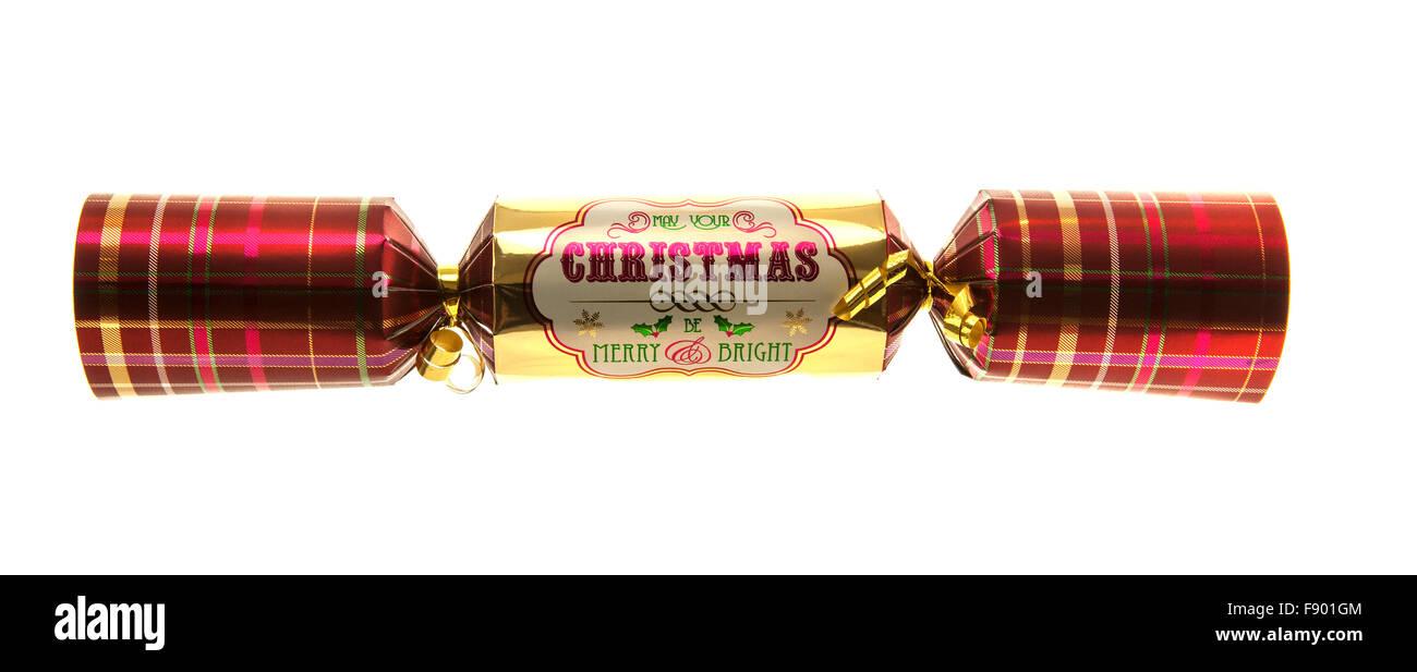 Cracker de navidad con tartan pattern aislado sobre fondo blanco. Imagen De Stock